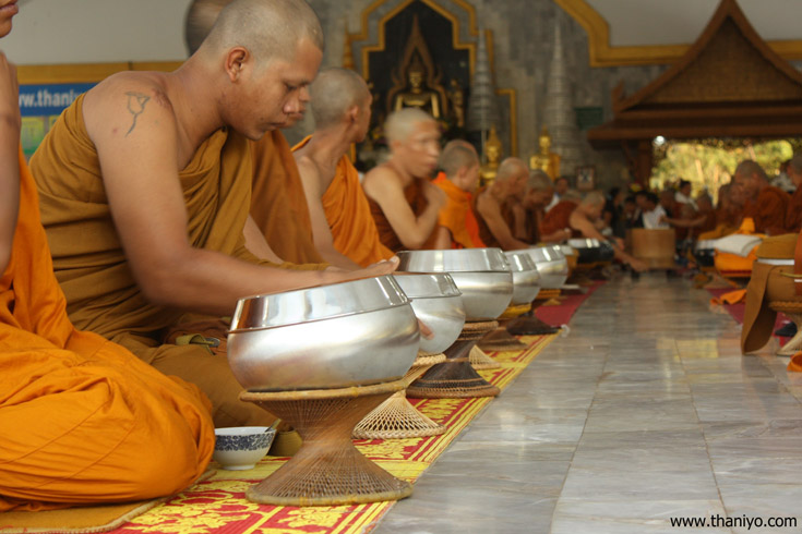 Returning to the temple, the monks sit together to eat breakfast, then make a blessing for world peace.