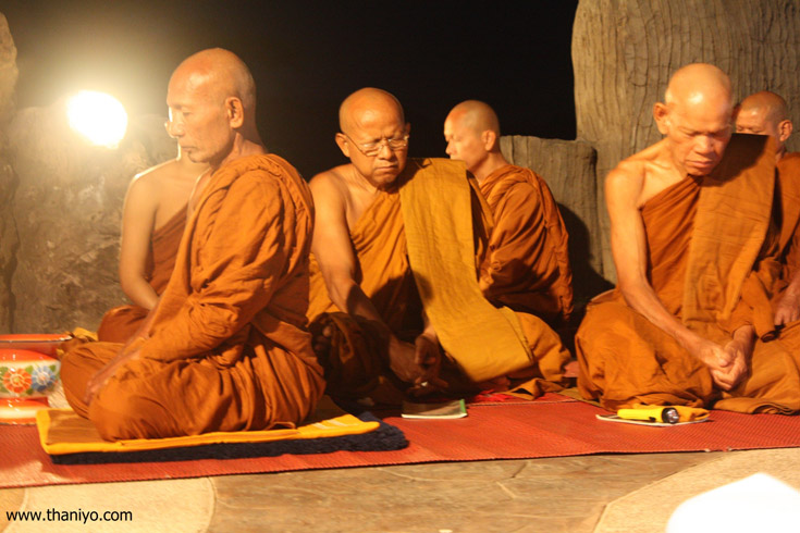 Doing a meditation by the monks