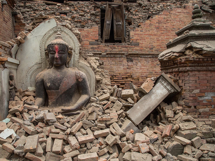 A Buddha statue is surrounded by debris from a collapsed temple in the UNESCO world heritage site of Bhaktapur on April 26, 2015 in Bhaktapur, Nepal.