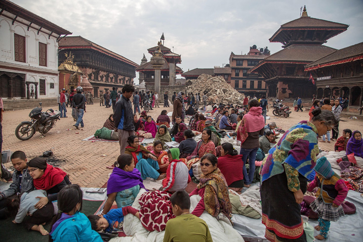 Residents sit in a square in Bhaktapur, Nepal after the earthquake, April 26, 2015.