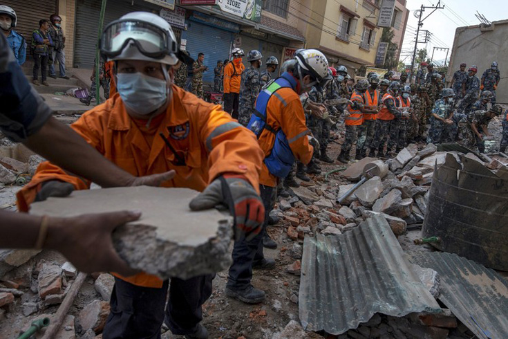 Nepalese military personnel remove debris in search of survivors in Kathmandu on Tuesday.