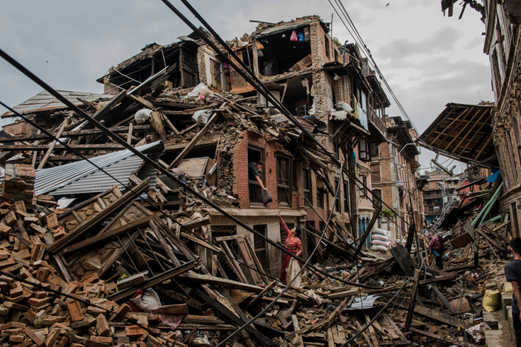 A husband passed salvaged belongings to his wife in their destroyed home in Bhaktapur, Nepal.  A 7.8-magnitude earthquake hit Nepal on April 25th, killing more than 8,000 people at the latest count.