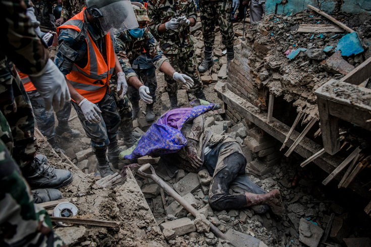 Members of a rescue team retrieved the body of an earthquake victim from the ruins of his home in Bhaktapur.