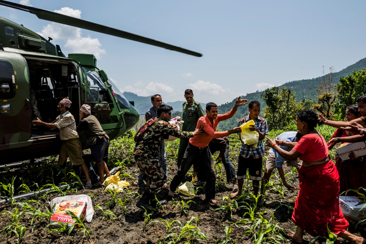 Villagers unloaded relief aid from an Indian Army helicopter in Ranehak, Nepal, near the epicenter of the quake. Since the earthquake struck in Nepal, the government instituted disaster-response plans, galvanizing the army and receiving planeloads of aid every day from dozens of countries.