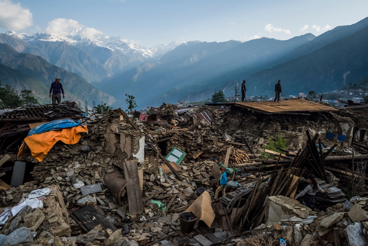 Villagers searched for their belongings in the rubble of their homes in the village of Barpak, Nepal.