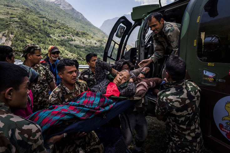 A Nepali villager injured by falling debris was evacuated from the village of Philim.