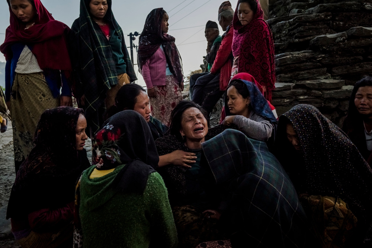Saainli Gurung, center, mourned the death of her son after his body was discovered in the village of Barpak, Nepal, near the epicenter of the earthquake.