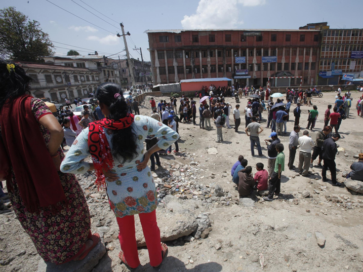 Residents gather in an open area after an earthquake hit in Kathmandu, Nepal, on Tuesday. It was the second major earthquake in less than three weeks.