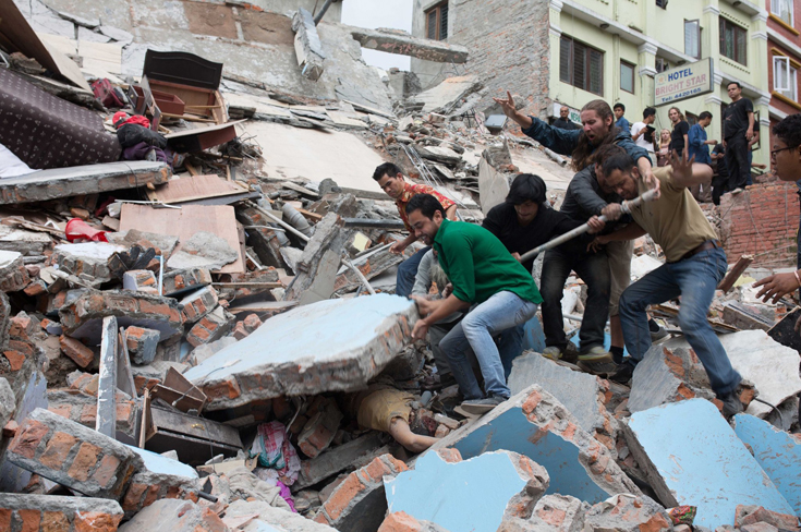 Rescuers lifted a concrete wall off a woman trapped in rubble after the earthquake in the Nepalese capital, Katmandu, on Saturday. The woman was dead when rescuers reached her.