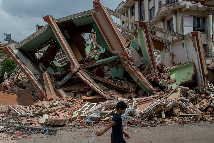 A resident of Kathmandu walks past rubble following a second devastating earthquake(Jonas Gratzer/Getty Images)