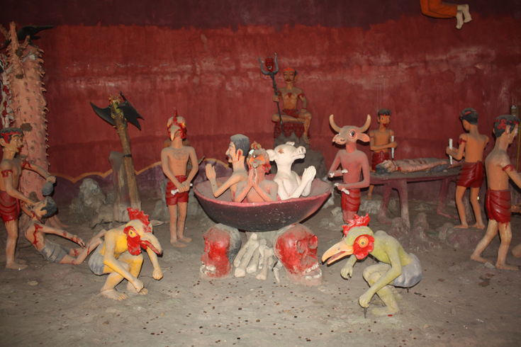 A diorama of torture appears inside the