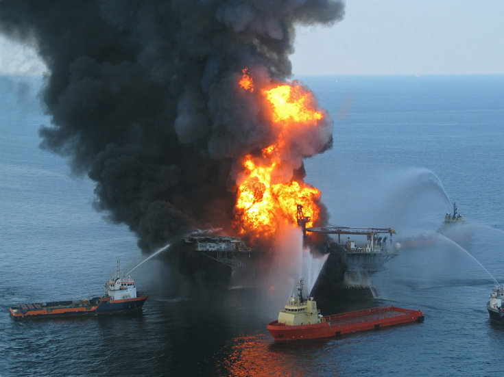 Anchor handling tugs and platform supply vessels combat the fire on the Deepwater Horizon while the U.S. Coast Guard searches for missing crew.