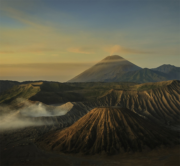 Mount Bromo (Indonesian: Gunung Bromo), is an active volcano and part of the Tengger massif, in East Java, Indonesia.